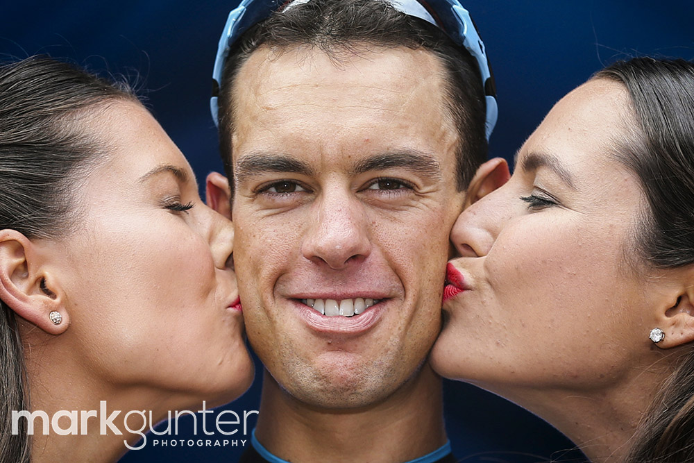 Richie Porte of Australia gets a kiss on the podium after winning stage 5 of the 2015 Tour Down Under cycling competition in Adelaide on January 24, 2015. The Tour Down Under is being held between January 18 to 25. MARK GUNTER